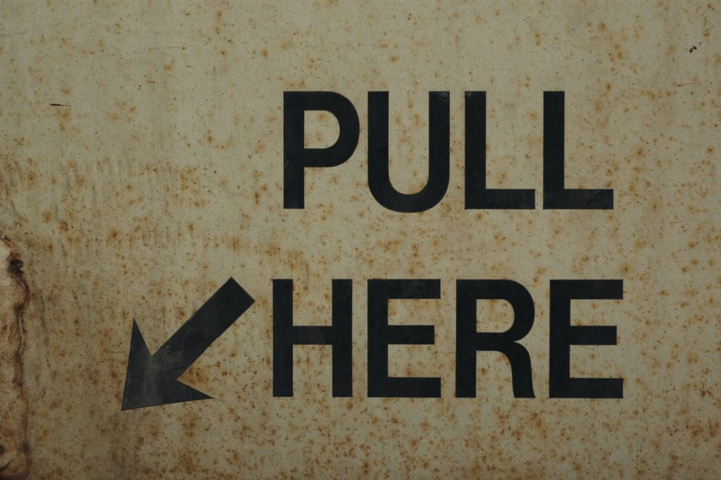 Pull here sign
